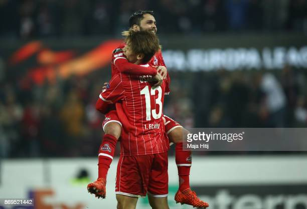 Yuya Osako of FC Koeln and Leonardo Jesus Bittencourt of FC Koeln celebrates after scoring his sides fourth goal during the UEFA Europa League group...