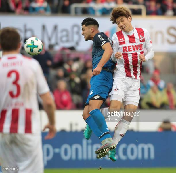 Yuya Osako of FC Koeln and Nadiem Amiri of Hoffenheim battle for the ball during the Bundesliga match between 1 FC Koeln und TSG 1899 Hoffenheim at...