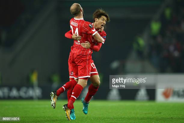 Yuya Osako of FC Koeln celebrates with teammates after scoring his sides second goal during the UEFA Europa League group H match between 1 FC Koeln...