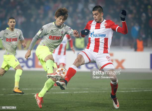 Yuya Osako of FC Koeln in action against Vujadin Savic of Crvena Zvezda during the UEFA Europa League group H match between Crvena Zvezda and 1 FC...