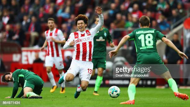Yuya Osako of FC Koeln is tackled and fouled by Thomas Delaney of Werder Bremen during the Bundesliga match between 1 FC Koeln and SV Werder Bremen...