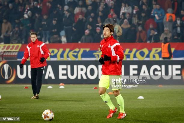 Yuya Osako of FC Koeln warms up prior to the UEFA Europa League group H match between Crvena Zvezda and 1 FC Koeln at stadium Rajko Mitic on December...