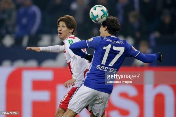 Yuya Osako of FC Koln Benjamin Stambouli of Schalke 04 during the German Bundesliga match between Schalke 04 v 1 FC Koln at the Veltins Arena on...