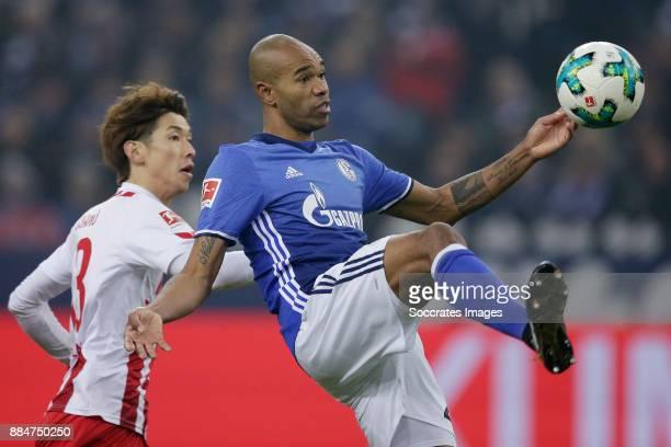 Yuya Osako of FC Koln Naldo of Schalke 04 during the German Bundesliga match between Schalke 04 v 1 FC Koln at the Veltins Arena on December 2 2017...