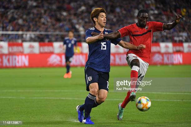 Yuya Osako of Japan and Akeem Humphrey of Trinidad and Tobago compete for the ball during the international friendly match between Japan and Trinidad...