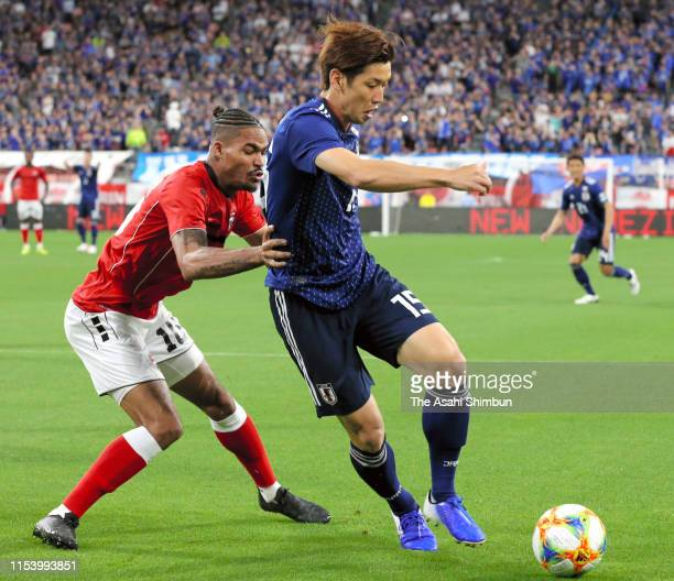 Yuya Osako of Japan and Alvin Jones of Trinidad Tobago compete for the ball during the international friendly match between Japan and Trinidad Tobago...