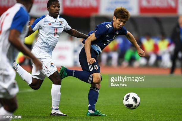 Yuya Osako of Japan and Armando Cooper of Panama compete for the ball during the international friendly match between Japan and Panama at Denka Big...