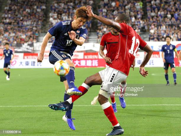 Yuya Osako of Japan and Carlyle Mitchell of Trinidad Tobago compete for the ball during the international friendly match between Japan and Trinidad...