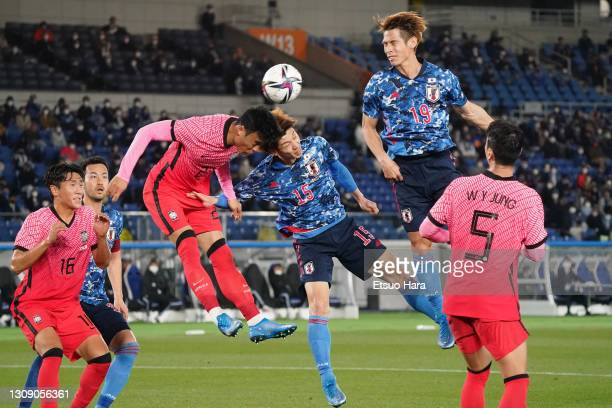 Yuya Osako of Japan and Kim Taehwan of South Korea compete for the ball during the international friendly match between Japan and South Korea at the...