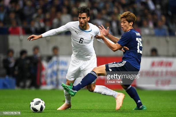 Yuya Osako of Japan and Rodrigo Bentancur of Uruguay compete for the ball during the international friendly match between Japan and Uruguay at...