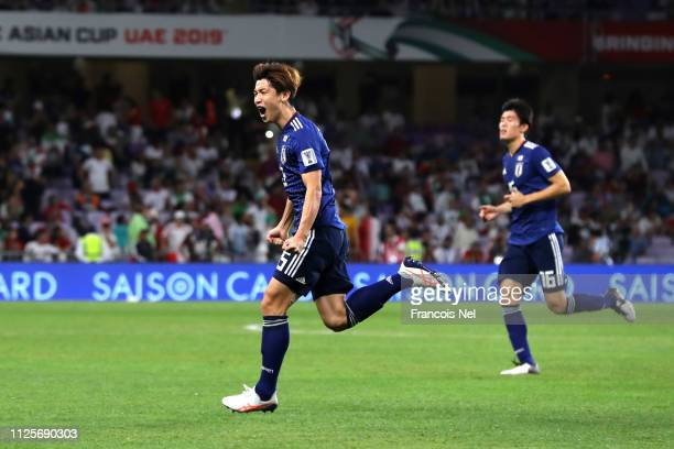 Yuya Osako of Japan celebrates after he scores his and his sides second goal during the AFC Asian Cup semi final match between Iran and Japan at...