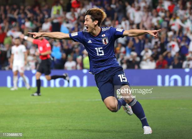Yuya Osako of Japan celebrates after scoring his sides first goal during the AFC Asian Cup semi final match between Iran and Japan at Hazza Bin Zayed...