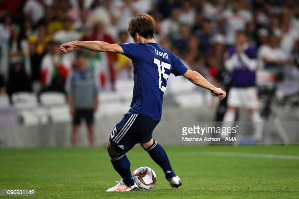 Yuya Osako of Japan celebrates scores a penalty to make it 0-2 during the AFC Asian Cup semi final match between Iran and Japan at Hazza Bin Zayed...