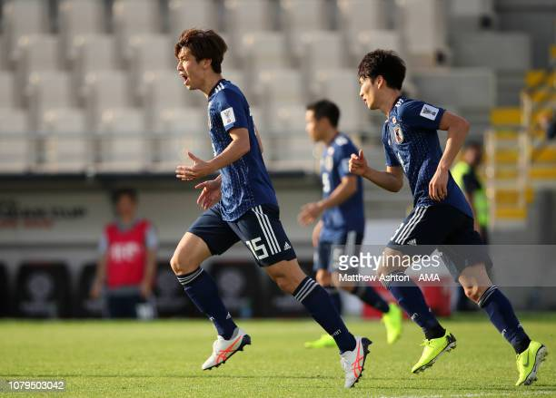 Yuya Osako of Japan celebrates scoring a goal to make it 11 during the AFC Asian Cup Group F match between Japan and Turkmenistan at Al Nahyan...