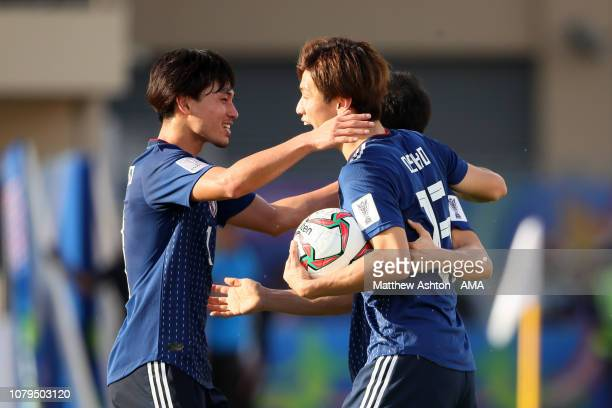 Yuya Osako of Japan celebrates scoring a goal to make it 21 during the AFC Asian Cup Group F match between Japan and Turkmenistan at Al Nahyan...