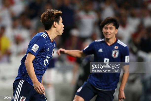 Yuya Osako of Japan celebrates scoring a penalty to make it 0-2 during the AFC Asian Cup semi final match between Iran and Japan at Hazza Bin Zayed...
