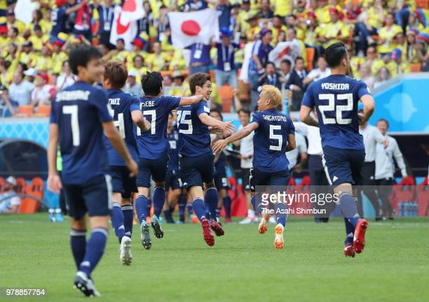 Yuya Osako of Japan celebrates scoring his side's second goal with his team mates during the 2018 FIFA World Cup Russia group H match between...