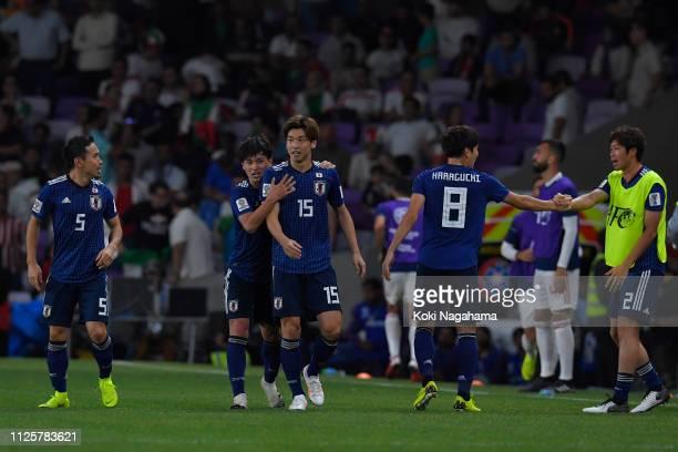 Yuya Osako of Japan celebrates scoring his teams second goal during the AFC Asian Cup semi final match between Iran and Japan at Hazza Bin Zayed...