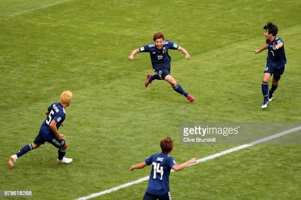 Yuya Osako of Japan celebrates scoring the 2nd Japan goal to make it 21 with Yuto Nagatomo Gaku Shibasaki and Takashi Inui of Japan during the 2018...