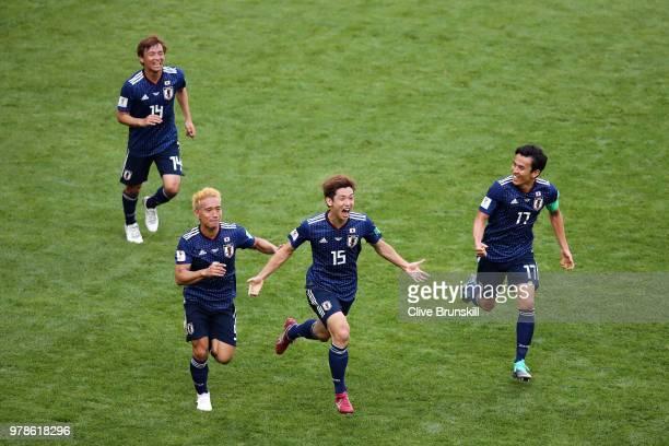 Yuya Osako of Japan celebrates scoring the 2nd Japan goal to make it 2-1 with Yuto Nagatomo, Gaku Shibasaki and Takashi Inui of Japan during the 2018...