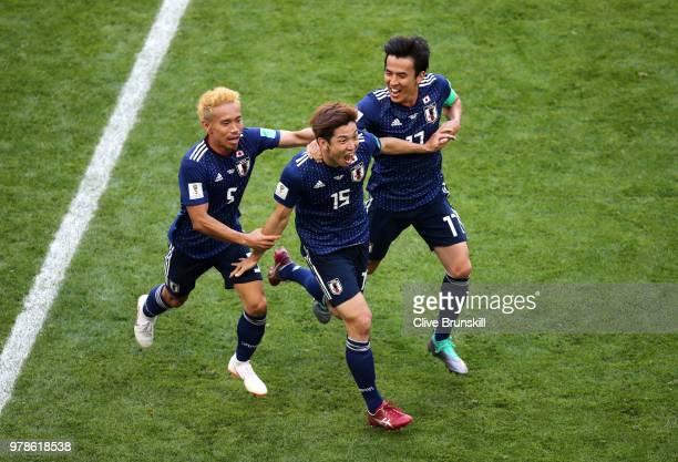 Yuya Osako of Japan celebrates scoring the 2nd Japan goal to make it 2-1 with Yuto Nagatomo and Makoto Hasebe of Japan during the 2018 FIFA World Cup...