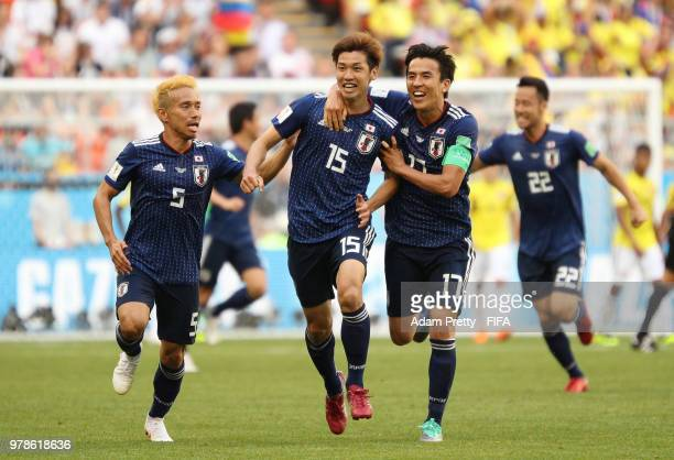 Yuya Osako of Japan celebrates scoring the 2nd Japan goal to make it 21 with Yuto Nagatomo and Makoto Hasebe of Japan during the 2018 FIFA World Cup...
