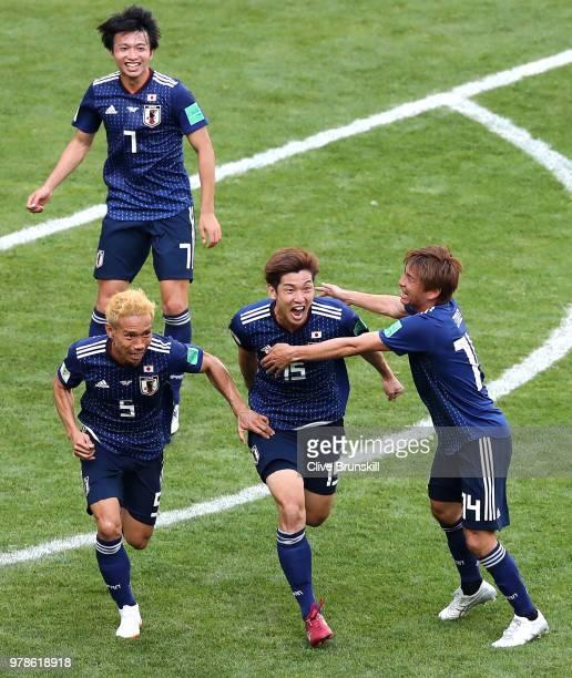 Yuya Osako of Japan celebrates scoring the 2nd Japan goal to make it 2-1 with Yuto Nagatomo, Takashi Inui and Makoto Hasebe of Japan during the 2018...