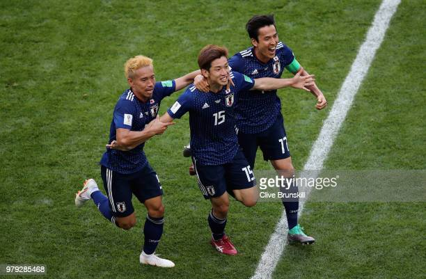 Yuya Osako of Japan celebrates scoring the 2nd Japan goal to make it 21 with Yuto Nagatomo and Makoto Hasebe of Japan during the 2018 FIFA World Cup...
