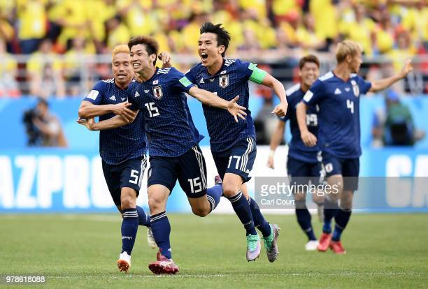 Yuya Osako of Japan celebrates with teammates after scoring his team's second goal during the 2018 FIFA World Cup Russia group H match between...