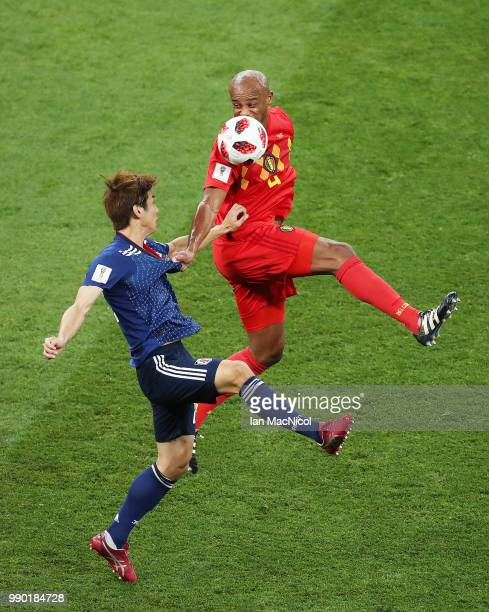 Yuya Osako of Japan challenges Vincent Kompany of Belgium during the 2018 FIFA World Cup Russia Round of 16 match between Belgium and Japan at Rostov...