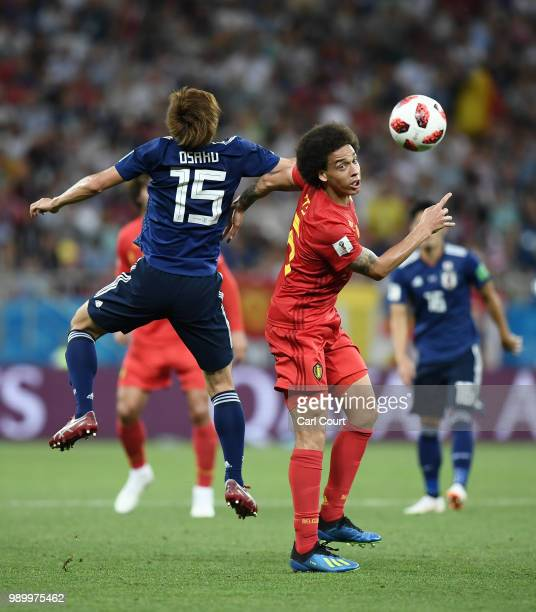 Yuya Osako of Japan competes for a header with Axel Witsel of Belgium during the 2018 FIFA World Cup Russia Round of 16 match between Belgium and...