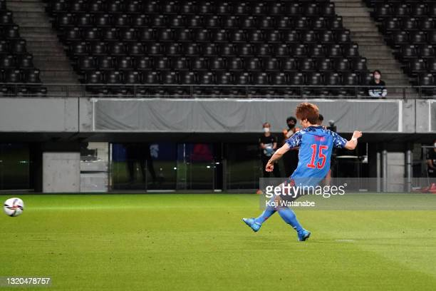 Yuya Osako of Japan converts the penalty to score his side's third goal during the FIFA World Cup Asian qualifier second round match between Japan...