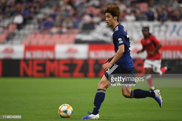 Yuya Osako of Japan dribbles the ball during the international friendly match between Japan and Trinidad and Tobago at Toyota Stadium on June 5 2019...