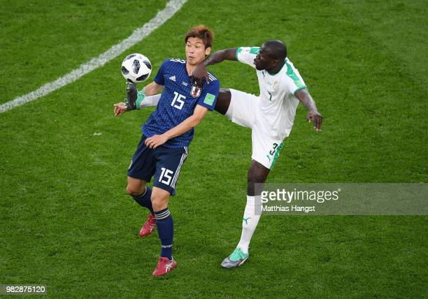 Yuya Osako of Japan is challenged by Kalidou Koulibaly of Senegal during the 2018 FIFA World Cup Russia group H match between Japan and Senegal at...