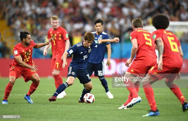 Yuya Osako of Japan is challenged by Nacer Chadli of Belgium during the 2018 FIFA World Cup Russia Round of 16 match between Belgium and Japan at...