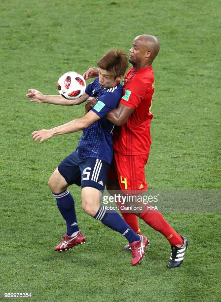 Yuya Osako of Japan is challenged by Vincent Kompany of Belgium during the 2018 FIFA World Cup Russia Round of 16 match between Belgium and Japan at...