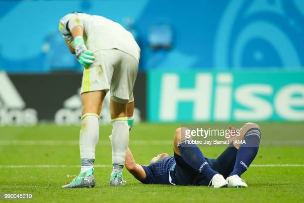 Yuya Osako of Japan is consoled by Eiji Kawashima of Japan during the 2018 FIFA World Cup Russia Round of 16 match between Belgium and Japan at...