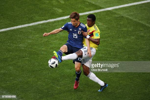 Yuya Osako of Japan is tackled by Oscar Murillo of Colombia during the 2018 FIFA World Cup Russia group H match between Colombia and Japan at...