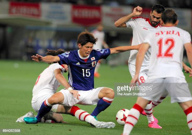 Yuya Osako of Japan is tackled during the international friendly match between Japan and Syria at Tokyo Stadium on June 7 2017 in Chofu Tokyo Japan