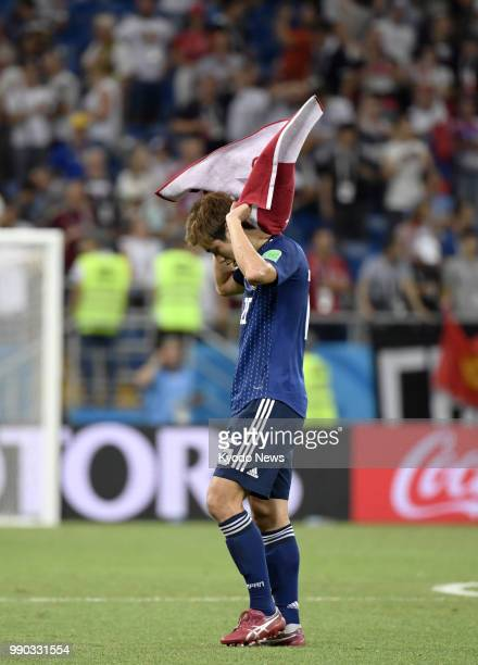 Yuya Osako of Japan looks dejected after a 32 loss to Belgium in the World Cup round of 16 in RostovOnDon Russia on July 2 2018 ==Kyodo