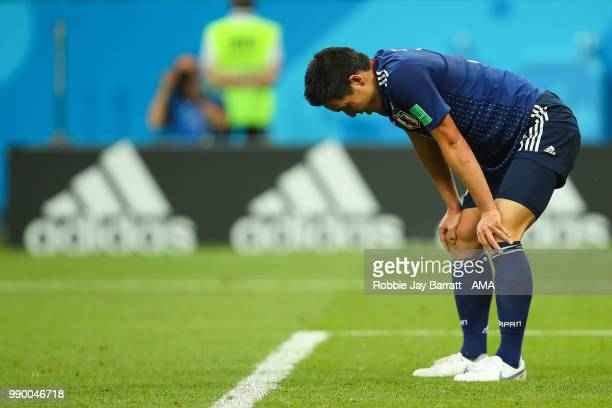Yuya Osako of Japan looks dejected after Nacer Chadli of Belgium's winning goal during the 2018 FIFA World Cup Russia Round of 16 match between...
