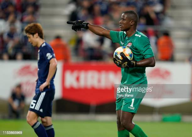 Yuya Osako of Japan reacts as goalkeeper Marvin Phillip of Trinidad and Tobago holds the ball during the international friendly match between Japan...