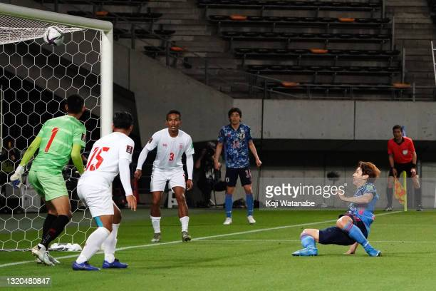 Yuya Osako of Japan scores his side's fourth and hat trick goal during the FIFA World Cup Asian qualifier second round match between Japan and...