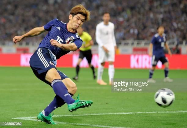 Yuya Osako of Japan scores his side's second goal during the international friendly match between Japan and Uruguay at Saitama Stadium on October 16,...