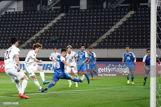 Yuya Osako of Japan scores his side's sixth goal during the FIFA World Cup Asian Qualifier second round between Mongolia and Japan at Fukuda Denshi...