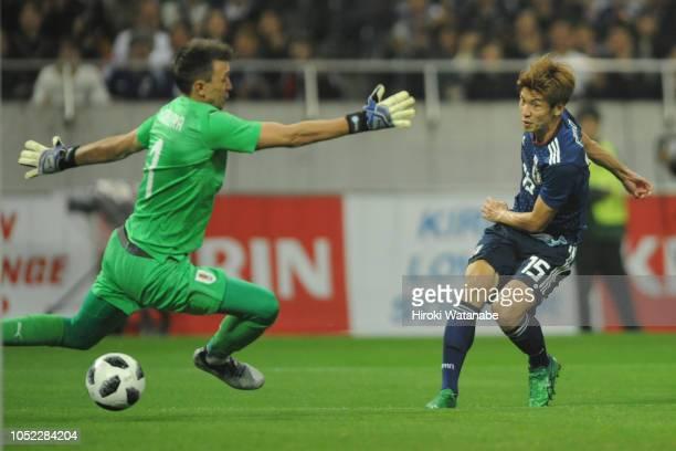 Yuya Osako of Japan scores his team's second goal during the international friendly match between Japan and Uruguay at Saitama Stadium on October 16...