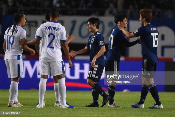 Yuya Osako of Japan shakes the hands with Tatefusa Kubo of Japan who amazes all the supporters during the international friendly match between Japan...