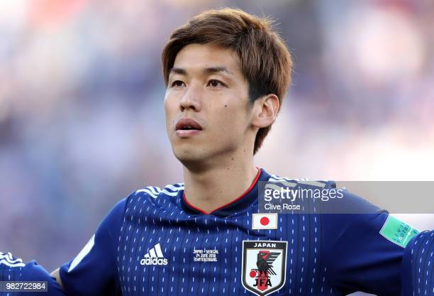 Yuya Osako of Japan sings the national anthem prior to the 2018 FIFA World Cup Russia group H match between Japan and Senegal at Ekaterinburg Arena...