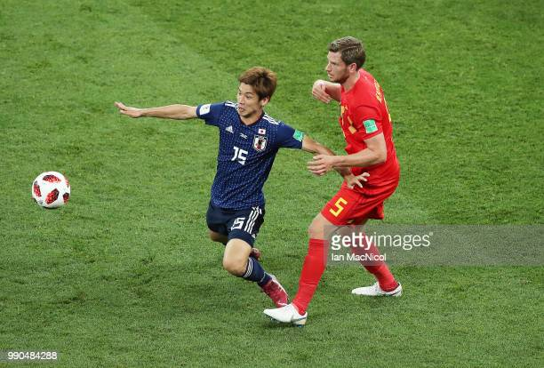 Yuya Osako of Japan vies with Jan Vertonghen of Belgium during the 2018 FIFA World Cup Russia Round of 16 match between Belgium and Japan at Rostov...