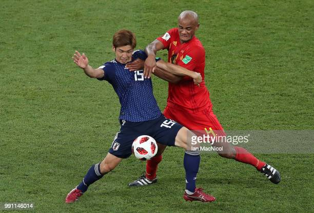 Yuya Osako of Japan vies with Vincent Kompany of Belgium during the 2018 FIFA World Cup Russia Round of 16 match between Belgium and Japan at Rostov...